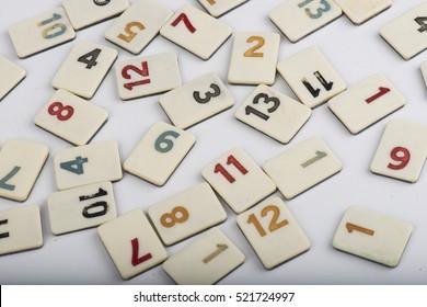 various rummikub pieces on white background