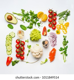 Various salad vegetables ingredients on white background, top view, flat lay. Healthy clean eating or diet food concept.