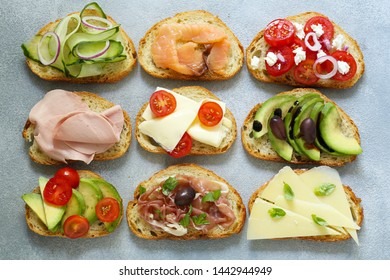 various sandwiches with vegetables and meat