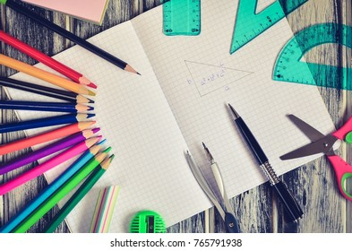 Various school supplies. Notebook and  mathematical accessories.