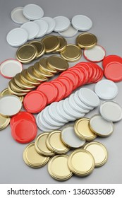 Various screw caps for glass jars. For canning, canned food. White, red, golden caps on gray background