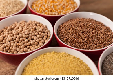 Various seeds and grains in bowls, diversified wholemeal plant based diet concept - close up