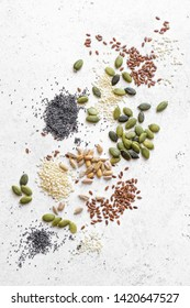 Various Seeds on white background. Assortment of seeds, healthy food ingredients, superfood, top view, copy space.