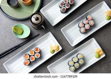 various set of maki sushi with background
