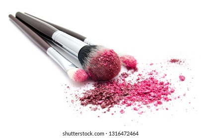 Various set of professional makeup brushes and colourful eye shadows isolated over white background