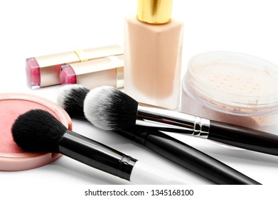 Various set of professional makeup brushes and cosmetics isolated over white background