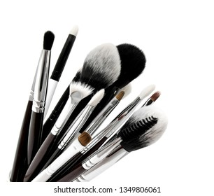 Various set of professional makeup brushes isolated over white background