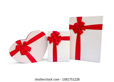 Various shapes of white boxes with a red ribbon bow Isolated on white background.