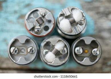 various single micro coil with cotton wick in high end rebuildable dripping atomizer vape gear, vaporizer equipment, selective focus with shallow depth of field
