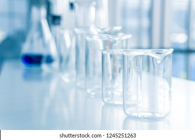 Various size of beakers and flasks. Science, biology and pharmaceutical industry concept.