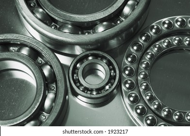 various sizes of ball-bearings against titanium