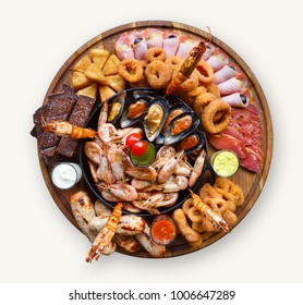 Various snacks platter isolated on white background. Shrimps, ham, sausge and crunchy fried onion rings on wooden plate. Cutout for beer pub menu, top view