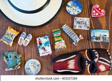 various souvenir and magnets from several world country arranged on the wooden background