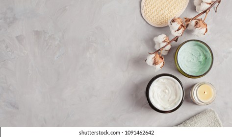 Various spa related objects on gray background, top view. Body and skin care flat lay with copy space. Beauty care concept