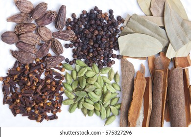 Various spices arranged on a white background