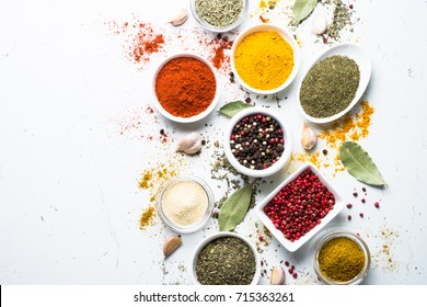 Various spices in a bowls on white background. Top view with copy space.