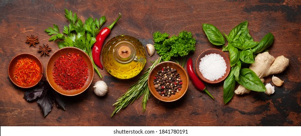 Various spices, herbs and condiments on wooden table. Indian cuisine. Top view flat lay