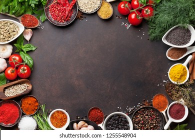 Various spices and herbs frame on stone table. Top view with space for your text