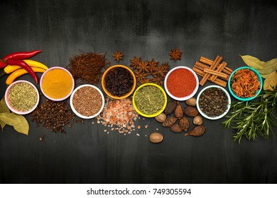 Various spices and herbs on wooden background