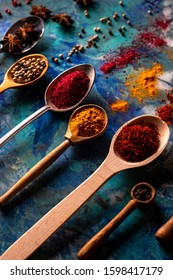 Various of spices and herbs in wooden spoons. Flat lay spices ingredients