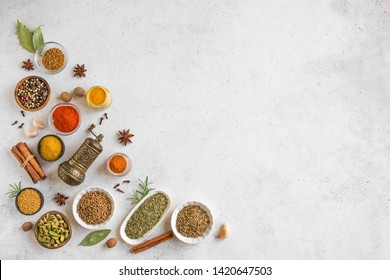 Various Spices on white background. Assortment, set of spices and condiments with vintage pepper mill, top view, copy space.