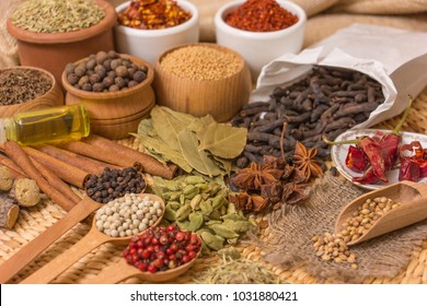 Various spices over a light on a straw background.
