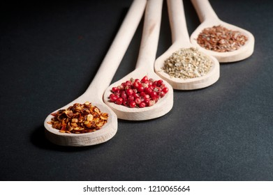 Various of spices in wooden spoons