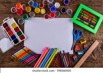 various stationery items on a wooden background with space for text top view