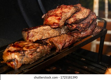 Various steak on the grill with ancho meat. Brazilian barbecue.