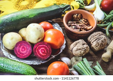 various summer and autumn vegetables and food for cooking on a wooden table.