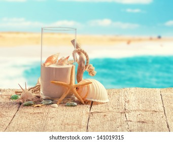 Various summer holiday items with blur beach on background