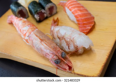 Various Sushi in Plate, Sushi is authentic luxury delicious Japanese food, Sushi with Salmon, Prawn, Tuna, Salmon Roe