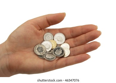 various swiss franc coins hold in open hand