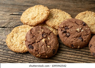 Various tasty cookies biscuits on wooden background
