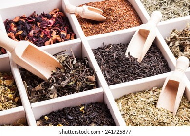 Various tea in a wooden box and scoops
