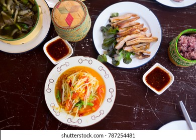 Various of Thai spicy food on rustic background, top view. Asian food concept.