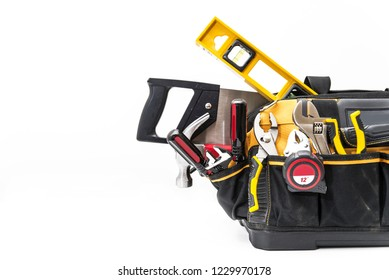 various tools in bag on white background close up