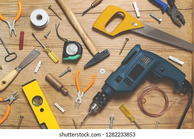 Various tools on wooden background - top view