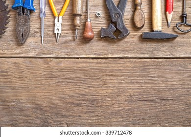 Various tools on  wooden background