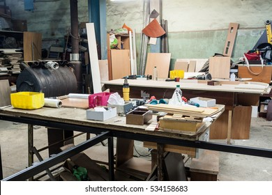 Various tools and supplies at carpentry workshop. Handmade business at small furniture factory.