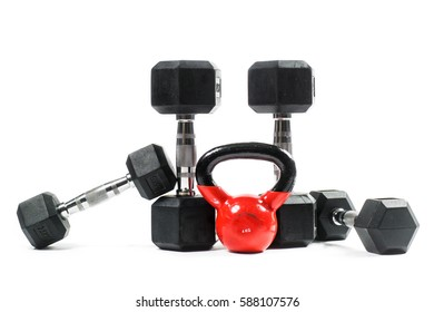 Various training weights isolated on white background. Dumbbells, weight training equipment.