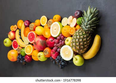 various tropical fruits on black background