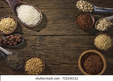 Various type of cereal grains Wheat, rice,brown rice, buckwheat, barley, black sesame,millet, Lotus seeds,Job's tears).Various raw uncooked grains on wood background