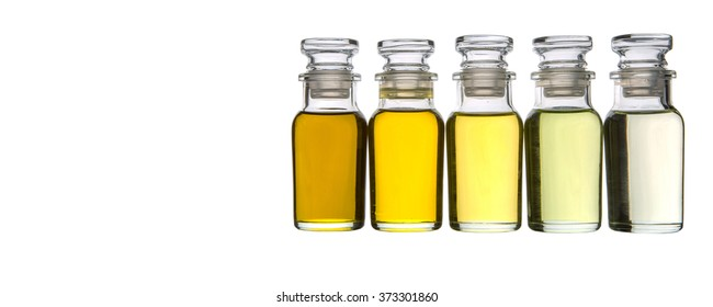 Various type of culinary oil in glass vial over white background