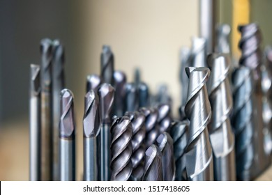 The various type  cutting tools of CNC machine on the stock shelf  in the store room. The set of CNC cutting tool , solid ball ,bull or radius ,flat or square, tapping endmill tools.