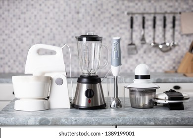 Various Type Of Kitchen Appliances On Worktop In Kitchen