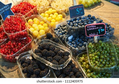 Various types of berries photographed at the covered market in Helsinki (Finland).