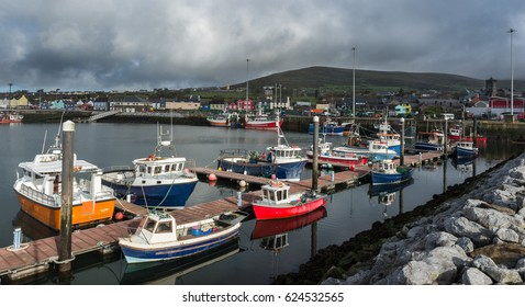 Various types of boats docked in Dingle bay harbour on the wild atlantic way in County Kerry, Ireland