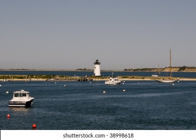 Various types of boats in Nantucket Sound near Edgartown Harbor Lighthouse