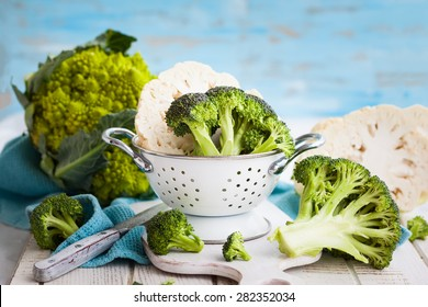 Various types of cabbage: romanesco, broccoli and cauliflower